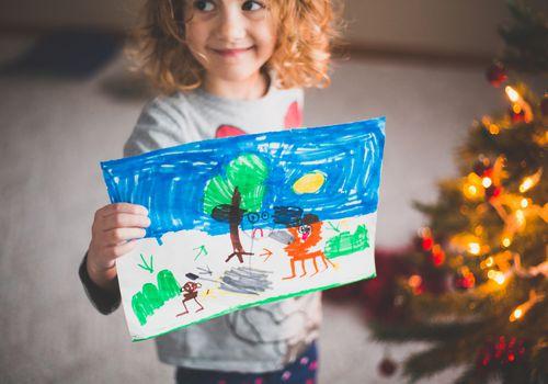 Proud Girl Holding up art work