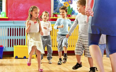 Children dancing together at a preschool