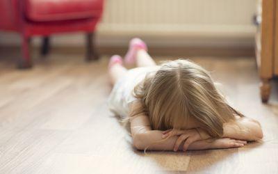 girl throwing a tantrum on floor