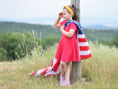 young girl holding an American flag