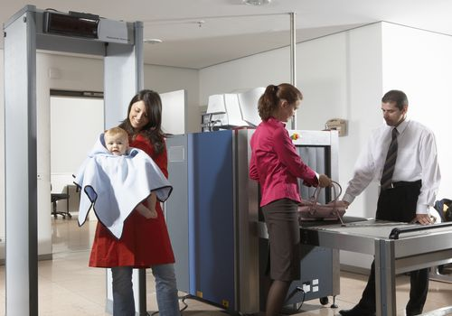 Woman with infant going through airport security
