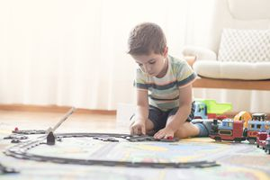 6 year old boy playing with trains