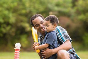 little boy playing t ball