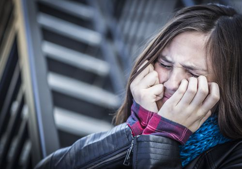 teen girl very distressed