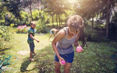 Children having water balloon fight