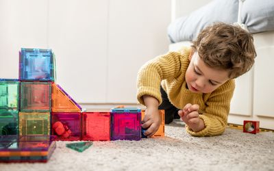 little boy playing with blocks