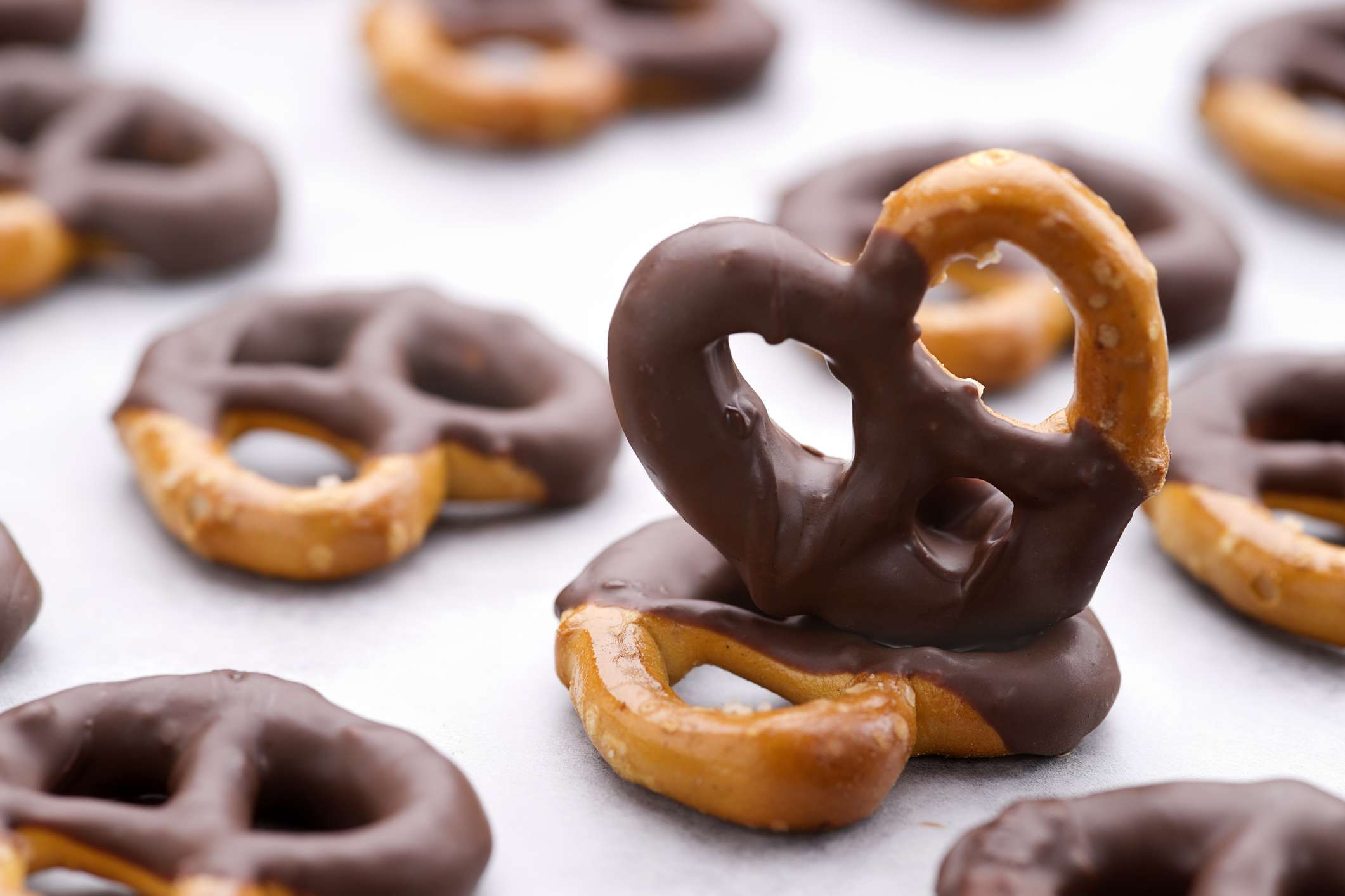 Chocolate dipped pretzels on a baking sheet