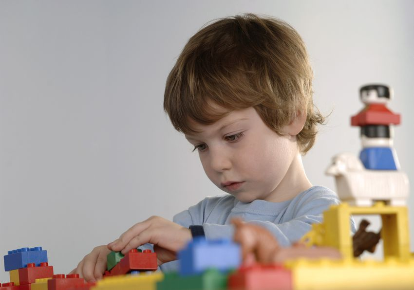 7 year old boy playing with legos
