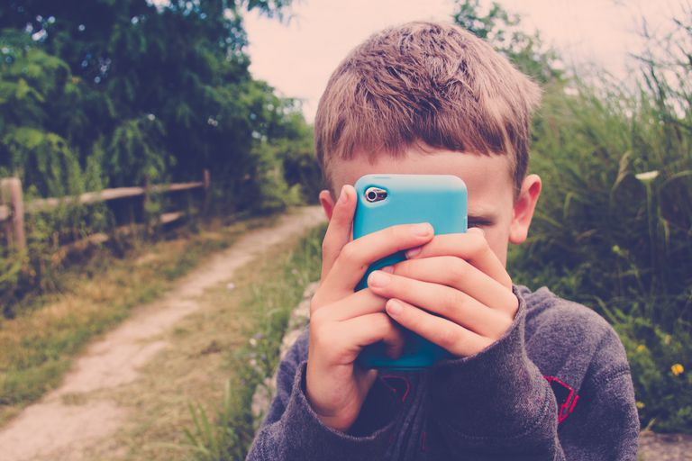 Young boy with a cell phone