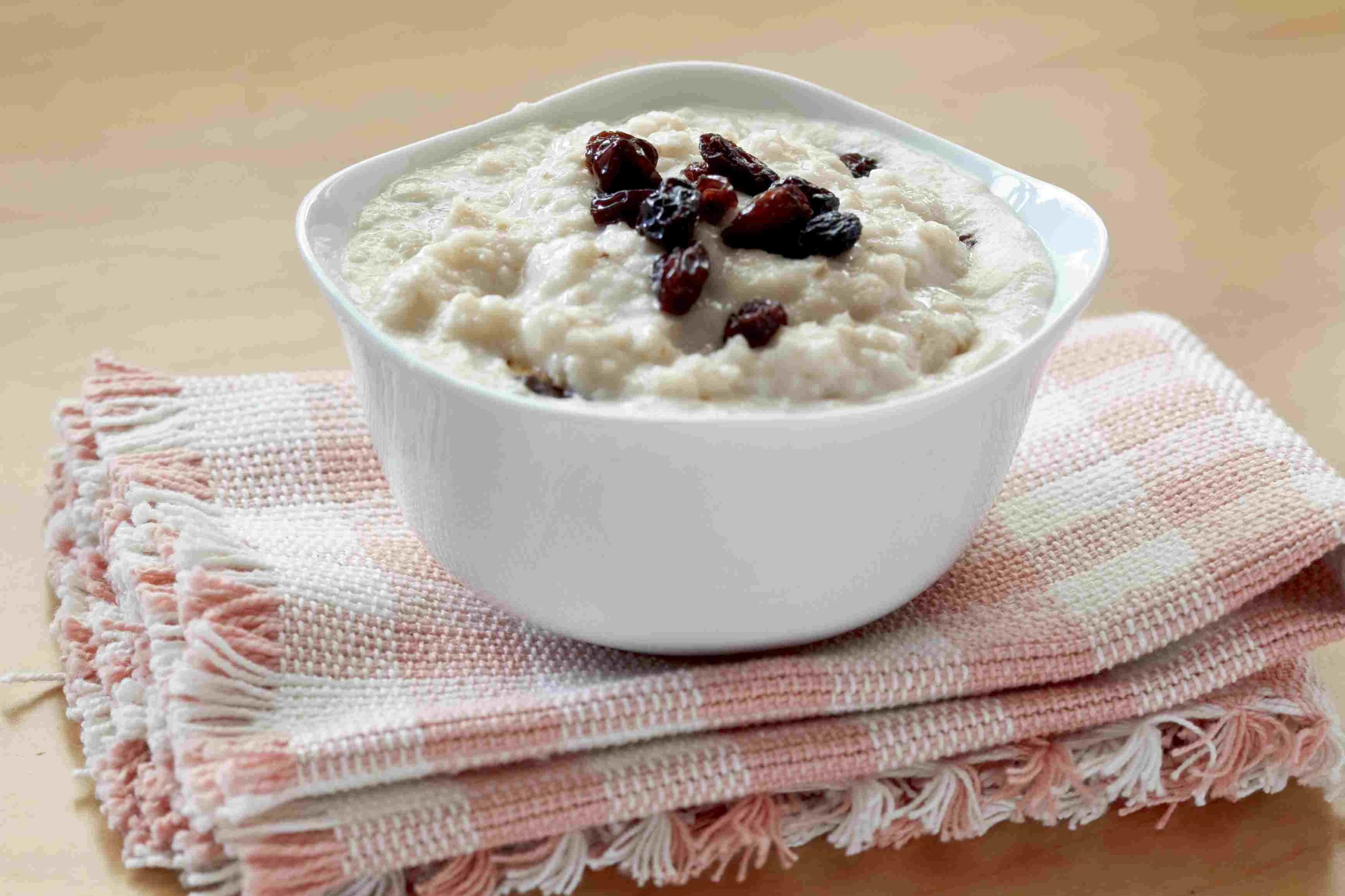 Bowl of oatmeal with raisins on top