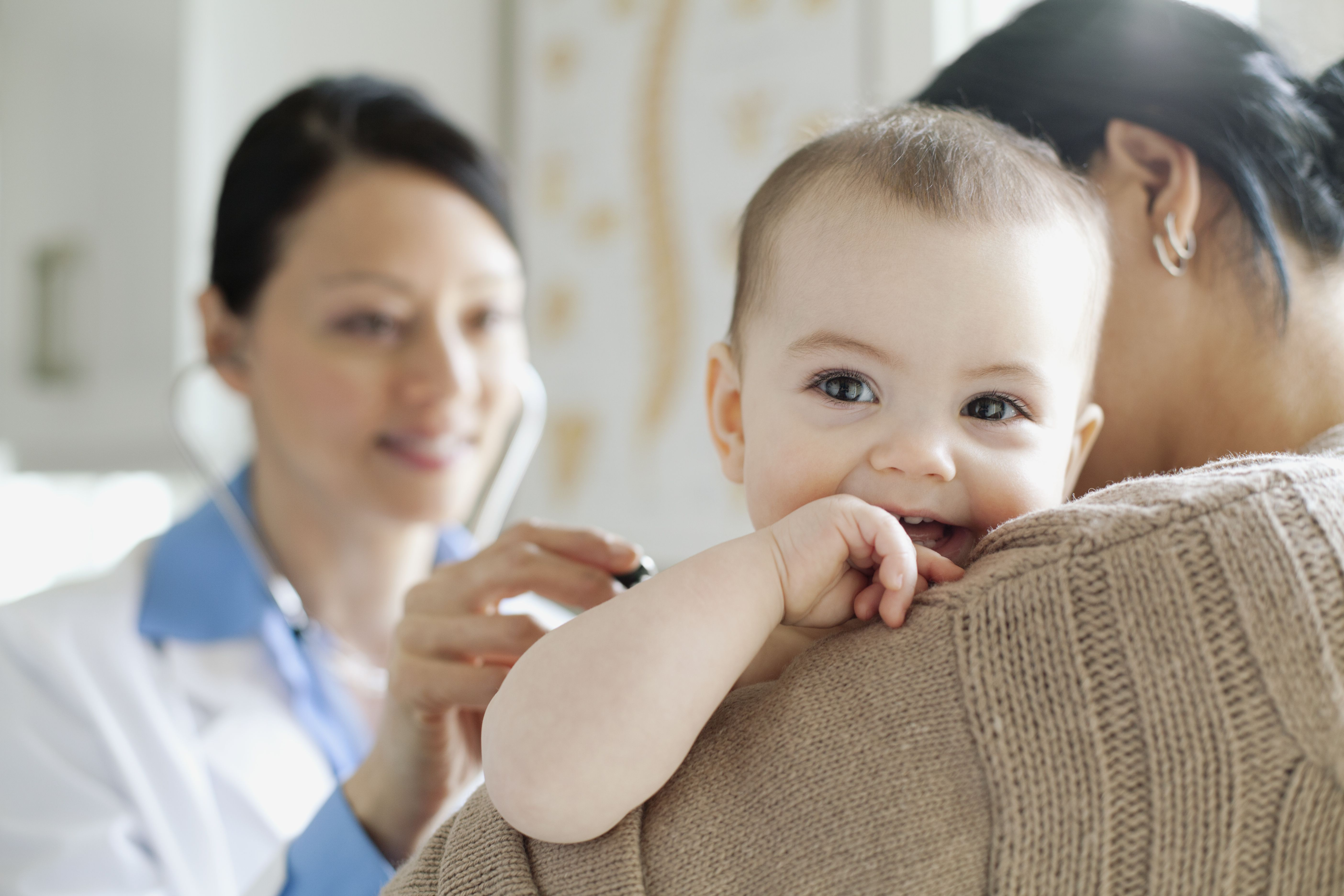 doctor examining baby