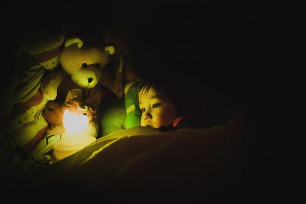 Child with night light