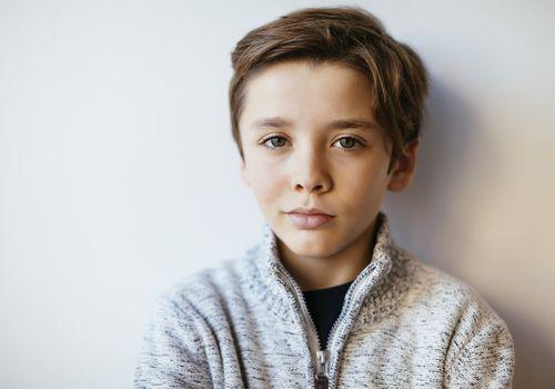 Portrait of a confident young brunette boy