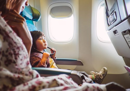 Mother and child riding on an airplane