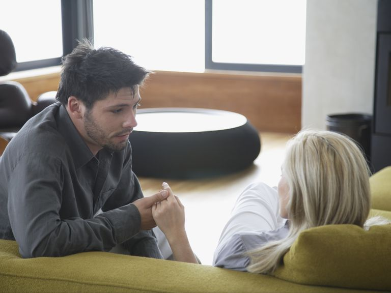 couple having serious conversation on couch