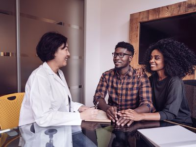 Couple having a conversation with their doctor.