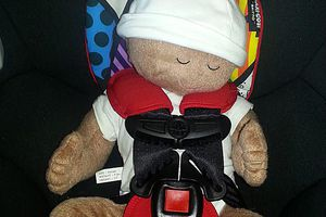 Doll in carseat
